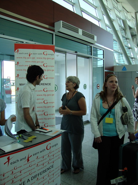 Greeting volunteers at the airport